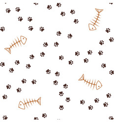 animal footprints and fish bones seamless vector image