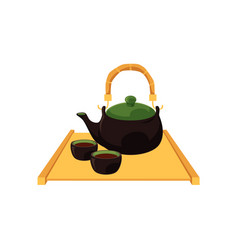 chinese japanese tea pot and cups on wooden trivet vector image