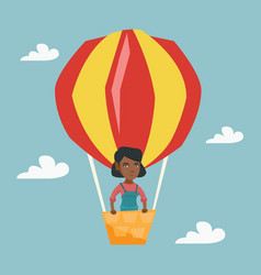 young african woman flying in hot air balloon vector image