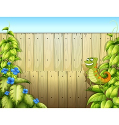 A lizard near the fence vector image vector image