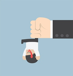 Businessman hanging from upside down by a big hand vector image vector image