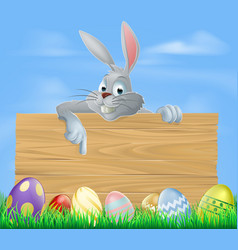 easter bunny and wooden sign vector image