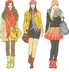 fashion stylish girls in warm clothes vector image
