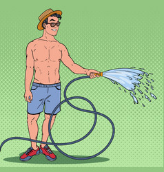 Pop art happy guy watering with garden hose vector