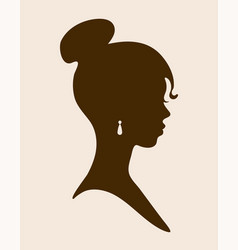 female silhouette with jewelry in ears vector image