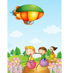 Three kids playing below an airship vector image