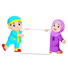 happy moslem kid holding blank sign vector image