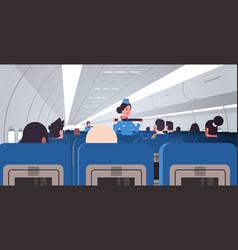 Stewardess explaining passengers how to use seat vector
