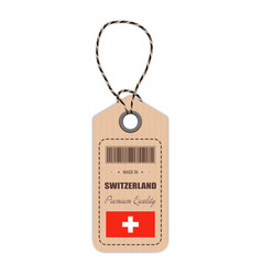 Hang tag made in switzerland with flag icon vector