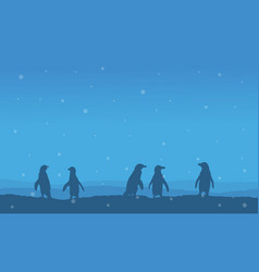 Silhouette of penguin lined on hill scenery vector