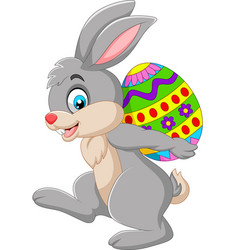 cartoon rabbit carrying an easter egg vector image