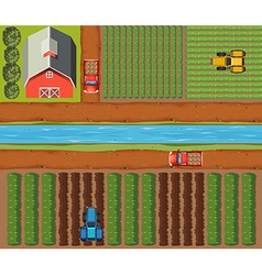 Aerial scene of farmlands with crops and barn vector