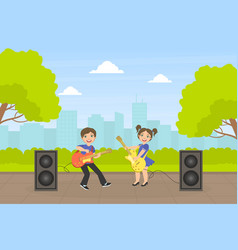 Cute girl and boy playing guitars outdoors vector