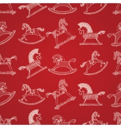 Christmas seamless pattern with rocking horses vector image