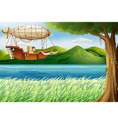 An airship near the river carrying two girls vector
