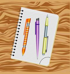 notebook orange pen purple pen and yellow pen vector image