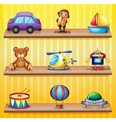 Different toys arranged at the wooden shelves vector image vector image