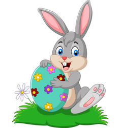 cartoon bunny holding easter egg vector image