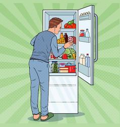 Pop art man looking inside fridge full food vector