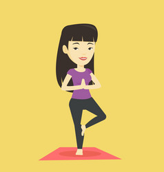 young woman practicing yoga tree pose vector image