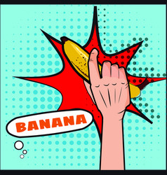 banana the hand holds a fruit pop art style vector image