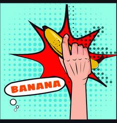 Banana the hand holds a fruit pop art style vector