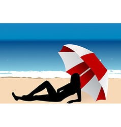 Young woman lying under an umbrella on the beach vector