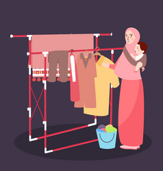 mom hanging clothes on the line wearing veil while vector image