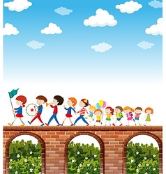 Children marching on the bridge vector