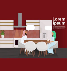 Arab couple drinking coffee sitting at table vector