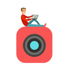 young smiling man sitting on a big mobile app vector image vector image