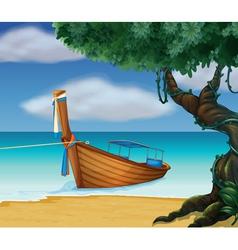 A wooden boat at the seashore vector