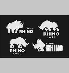 african rhino silhouette set logos on a dark vector image