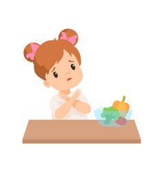 Cute little girl does not want to eat vegetables vector