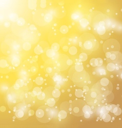 Abstract bokeh blur gold background vector