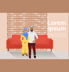 Arab couple sitting on couch in modern loft living vector