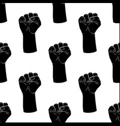 Raised fists silhouette seamless pattern vintage vector