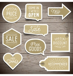 Stickers on rustic wood background for retail vector