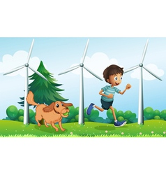 A boy and his dog near the three windmills vector image