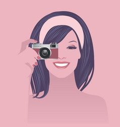 Beautiful smiling girl holding a retro photo vector