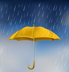 Yellow umbrella in rain vector image