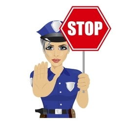 Young policewoman holding stop sign vector