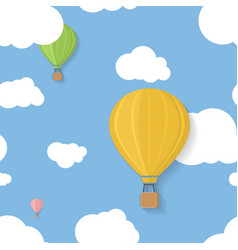 Three coloured aerostats in blue skies with clouds vector image vector image