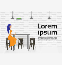 arab woman drinking coffee in modern cafe sitting vector image