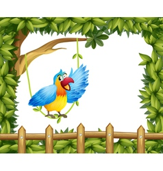 A parrot and leafy green border vector