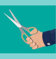 scissors with grey plastic handles in hand vector image