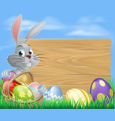rabbit with eggs basket and easter sign vector image