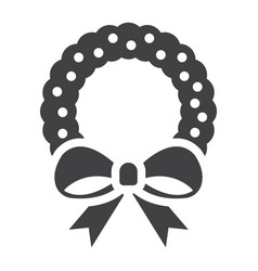 christmas wreath with bow glyph icon new year vector image