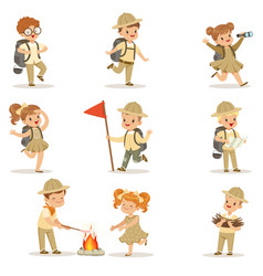 Set girls and boys in scout costumes vector
