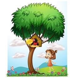 A girl in the garden with a bird in a bird house vector image